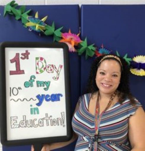 Picture of Assistant Principal, Xanthe McFadden. She is standing by a sign that says 1st day of my 10th year in Education.